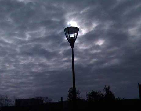 Winter streetlamp with sun shining through